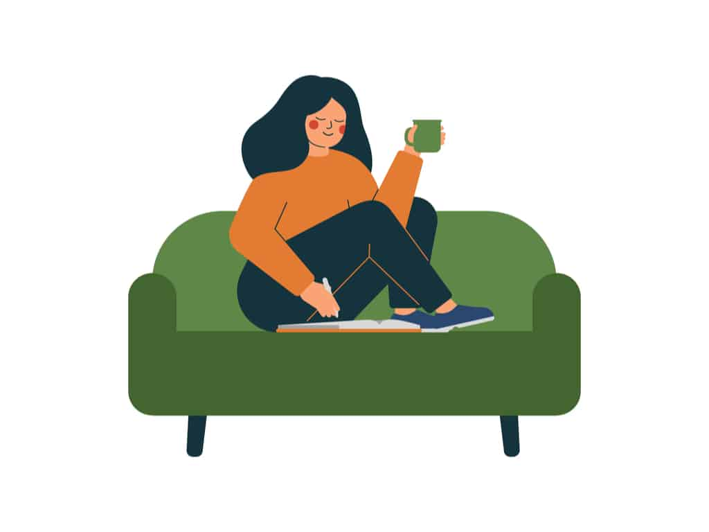 Woman sitting in sofa doing word search puzzles