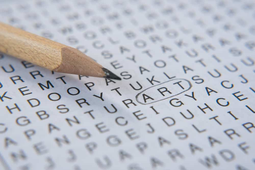 Word search puzzle with art word circled