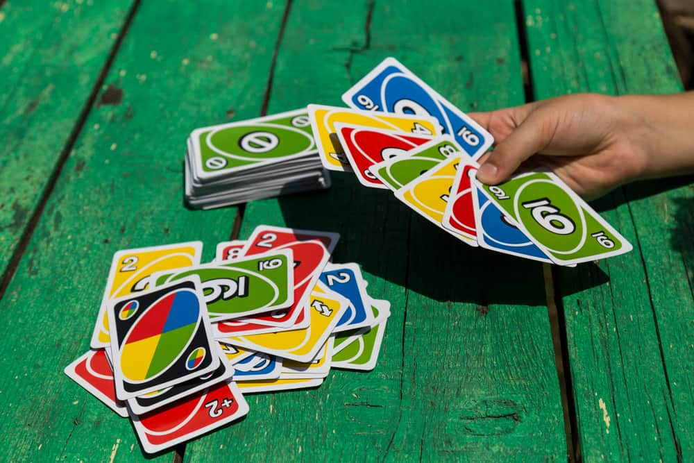 card game UNO on green table
