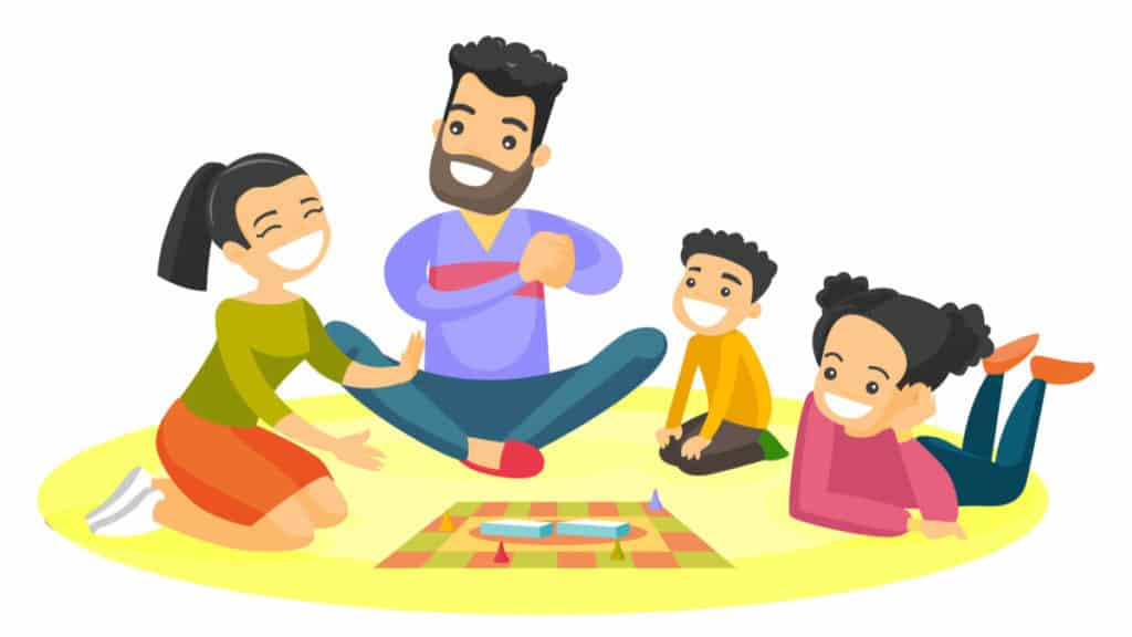 family sitting on the floor and playing together a board game at home