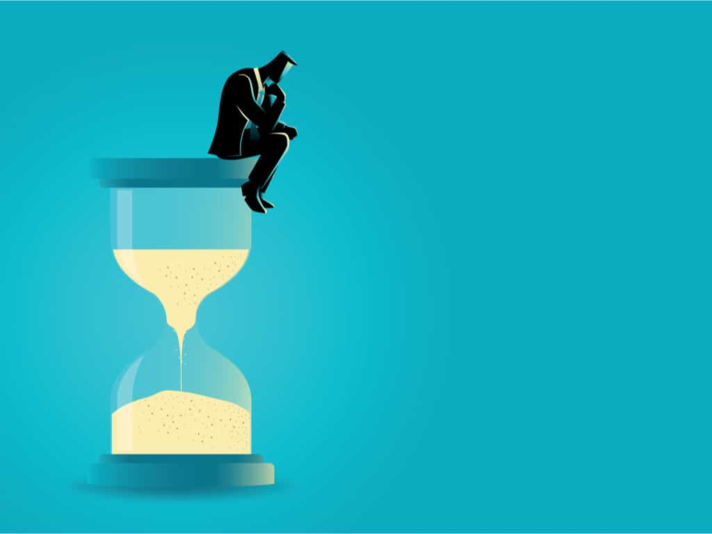 illustration of a man sitting and thinking on hourglass