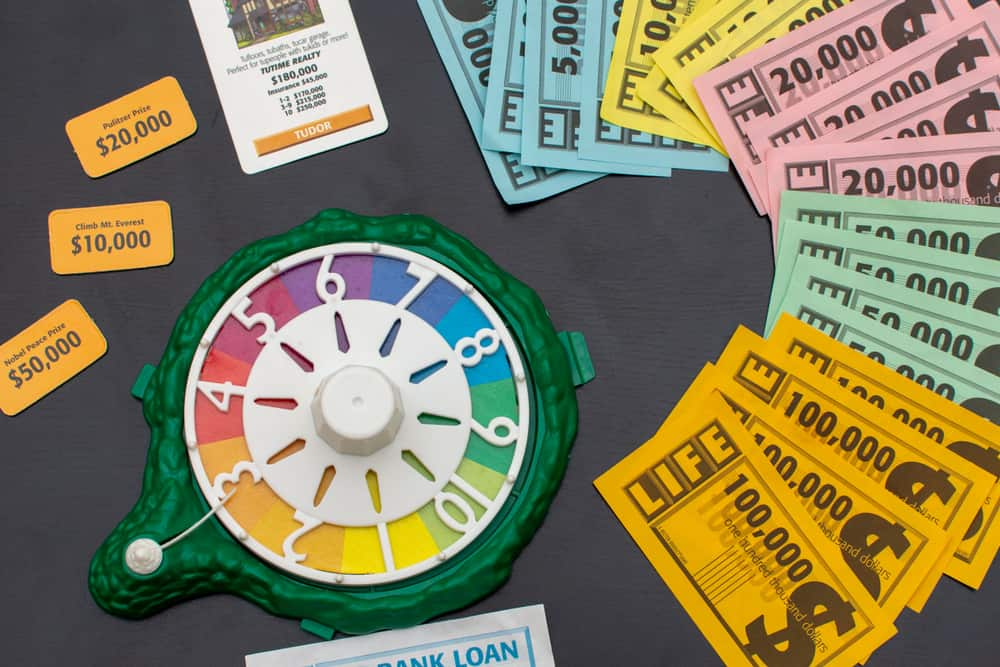Game of Life Money out on the table and set-up materials