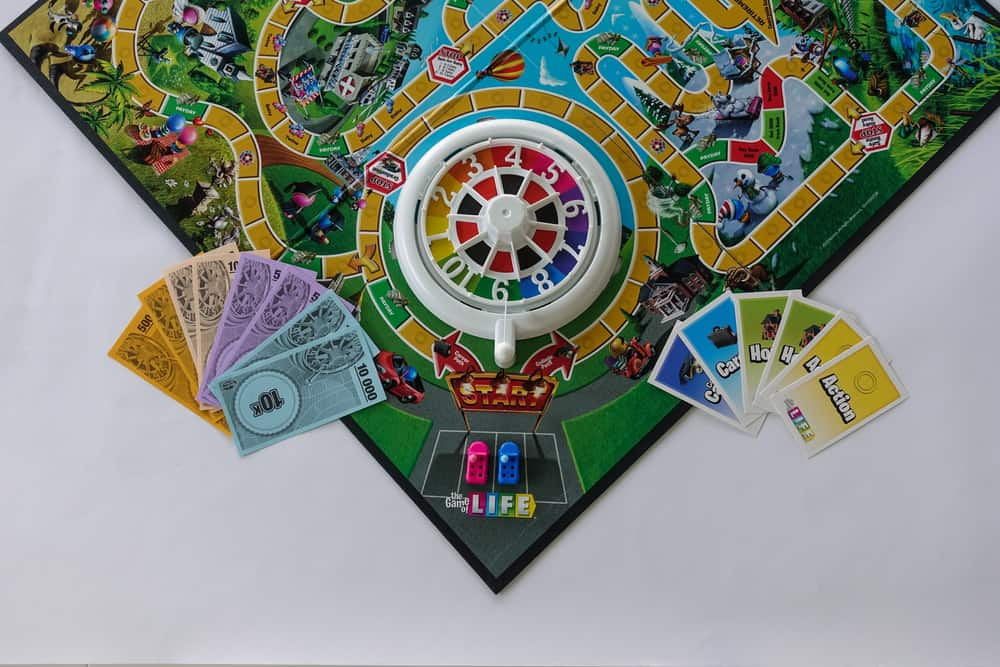 Game of Life by Hasbro with all of the game pieces on the board