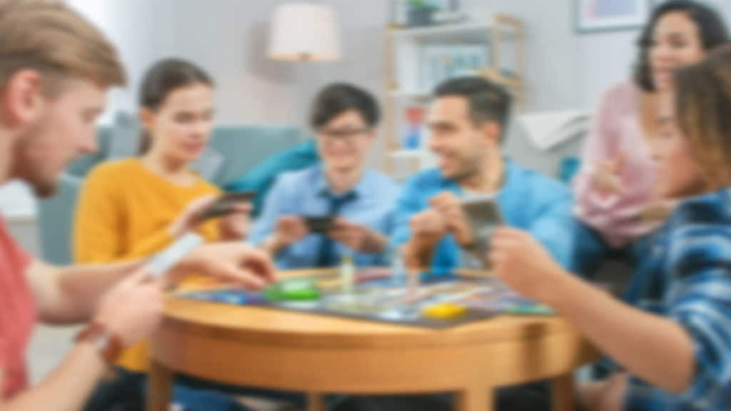 Group of friends playing a Strategic Board Game