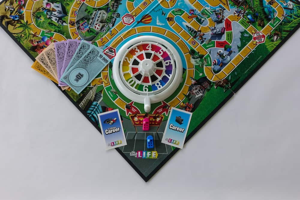 Game of Life by Hasbro with the career choice of going to college or not