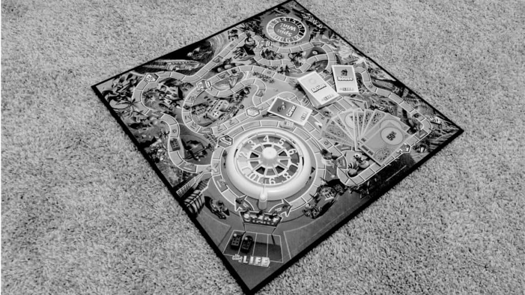 Game of Life with game pieces on the board (white and black)