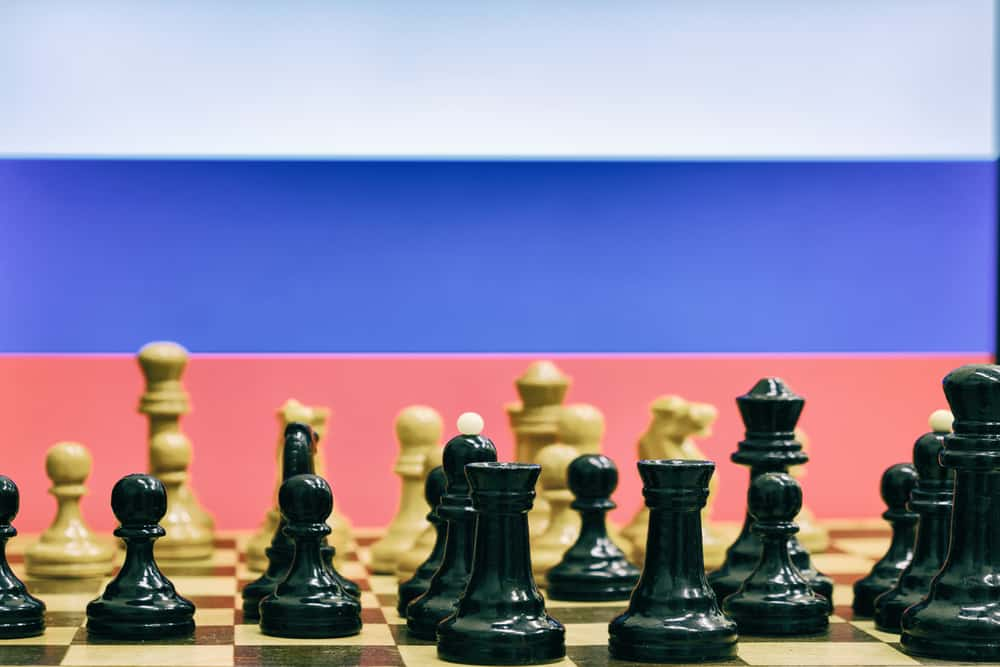 Russia flag on the background of chess with pieces on the Board