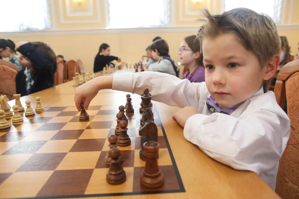 Saint Petersburg, Russia - Chess pieces on a chess Board. Children play chess