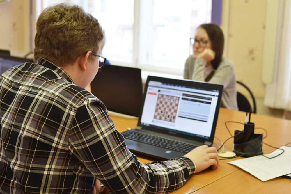 Syktyvkar, Russia - Children play chess online on laptops in school