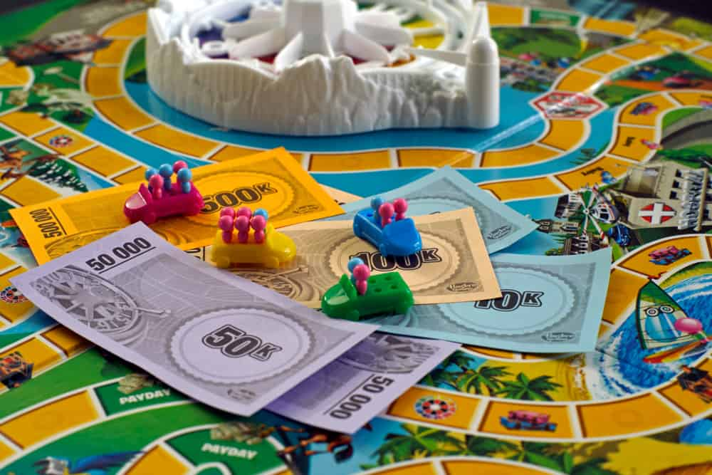 The Game of Life, board game - bills and tokens