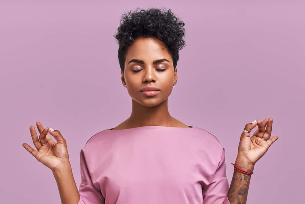 Calm woman relaxing and meditating - Emotional Skills