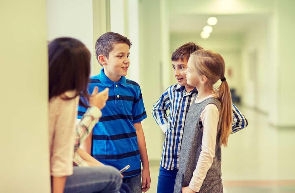 Children having a conversation in school