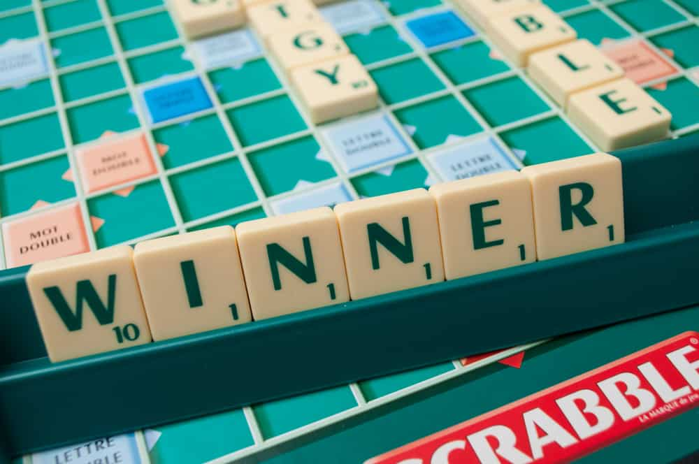 Closeup of plastic letters on Scrabble board game forming the word - winner