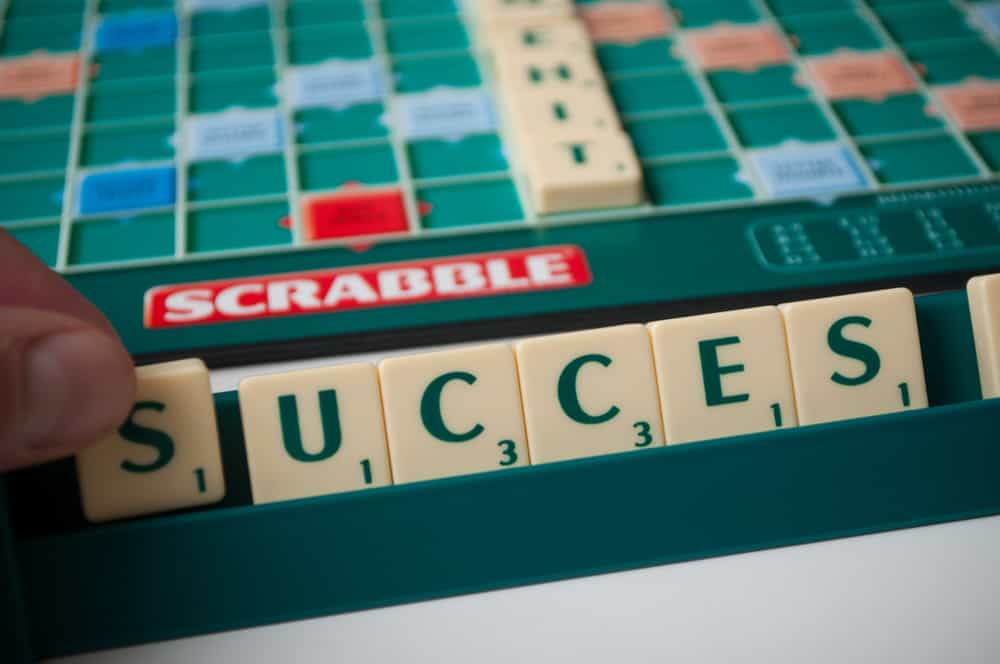 Closeup of plastic letters with word success on Scrabble board game