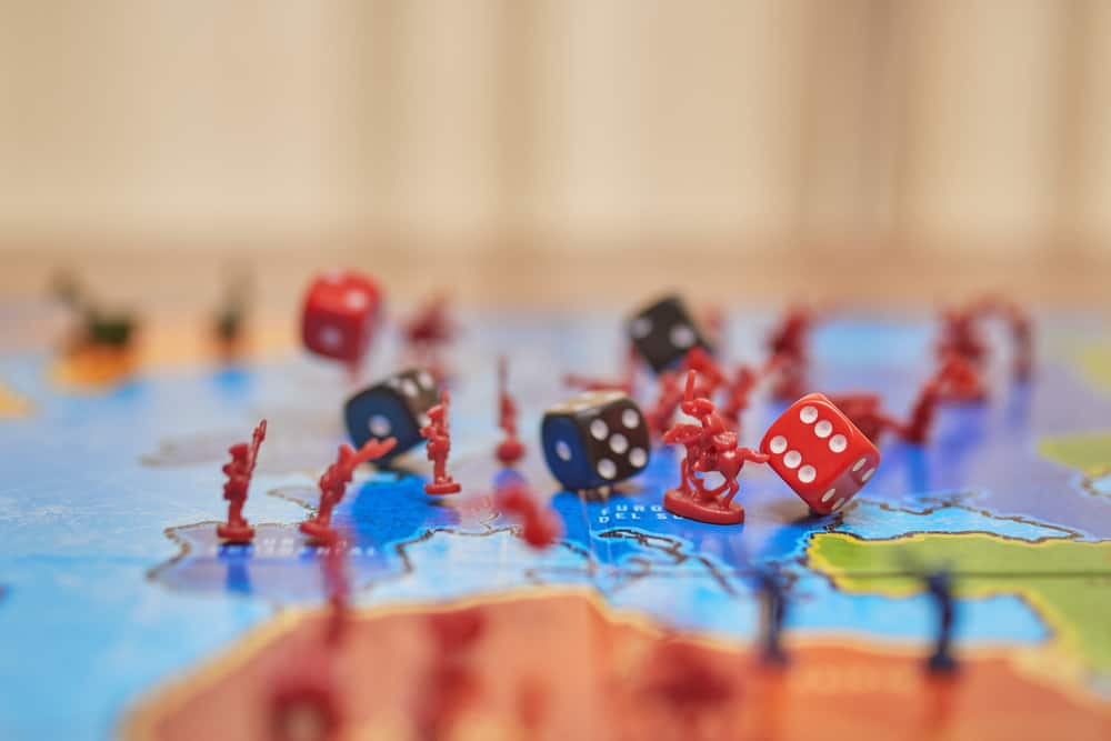 Risk board game, dice falling on top