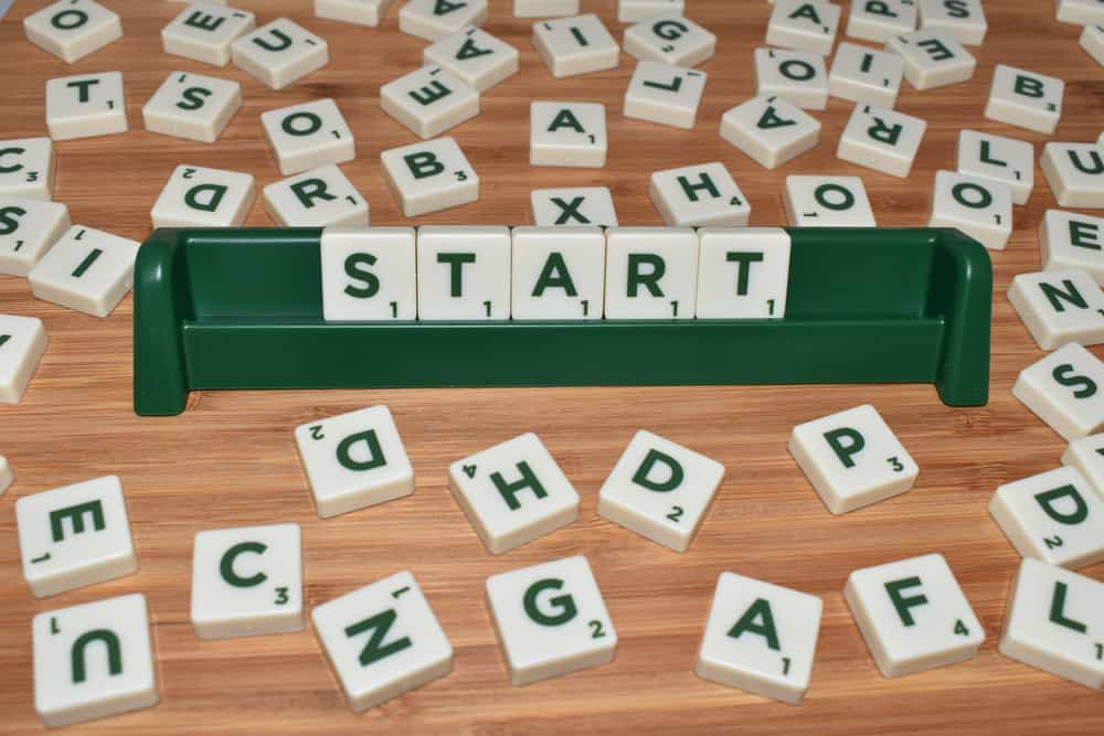 Scrabble - Start word made up of letter tiles surrounded by letters