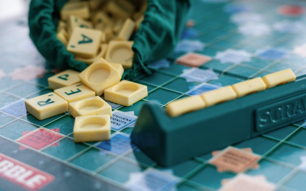 Scrabble board game with letters