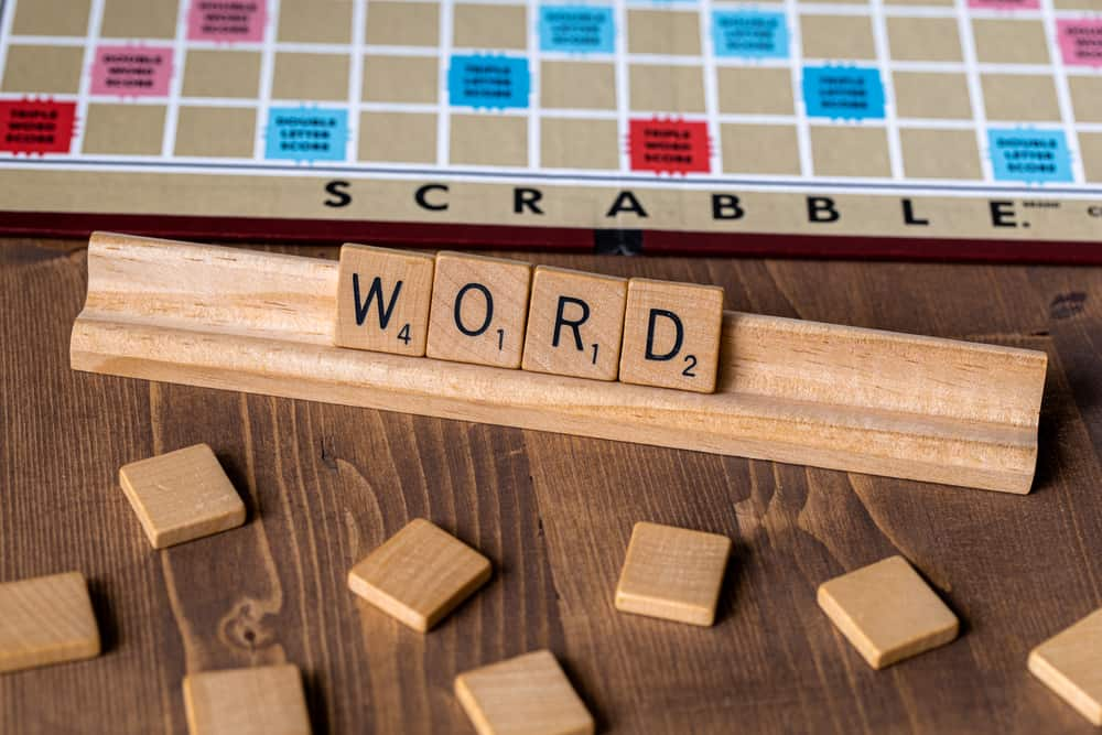 Scrabble board game with the scrabble tile spell Word
