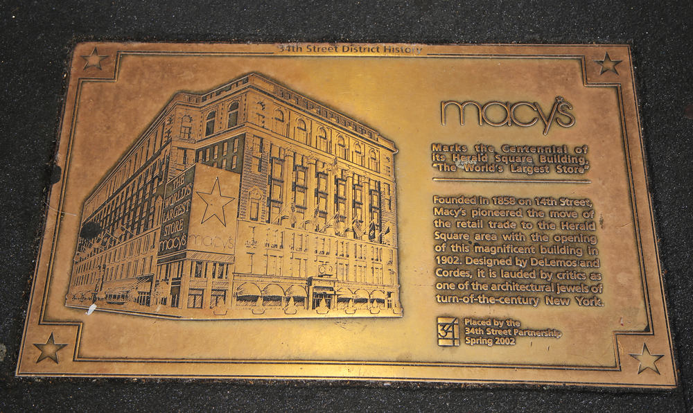 Sign marks the centennial of its Macy's Herald Square Building in midtown Manhattan