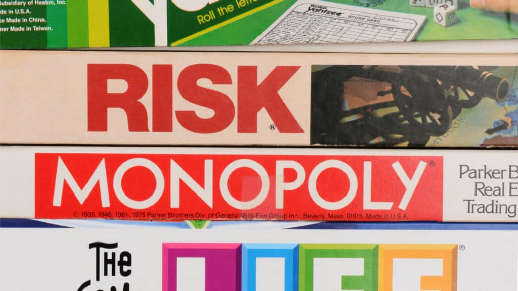 Stack of Board Games, including Monopoly and Risk