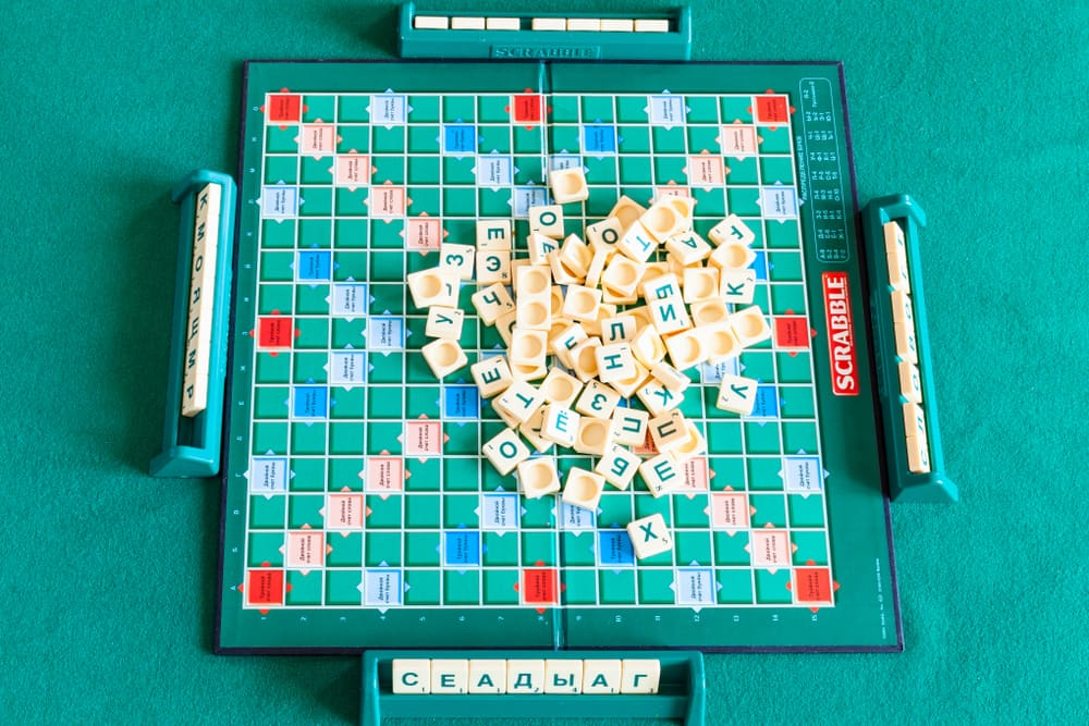 Top view of pile of letter tiles on board of Scrabble game