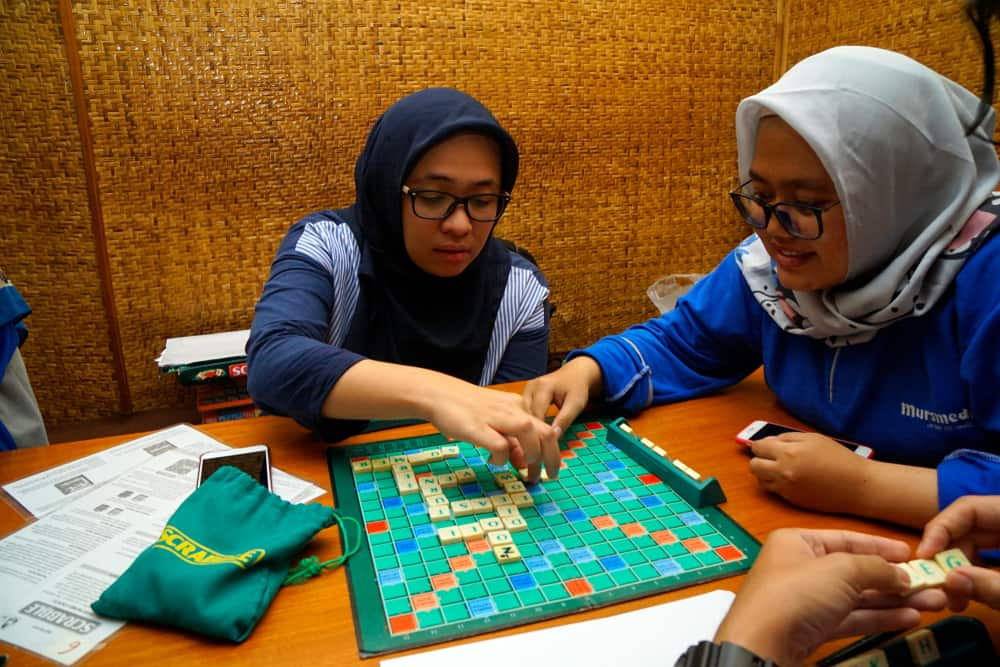 Two woman playing Scrabble
