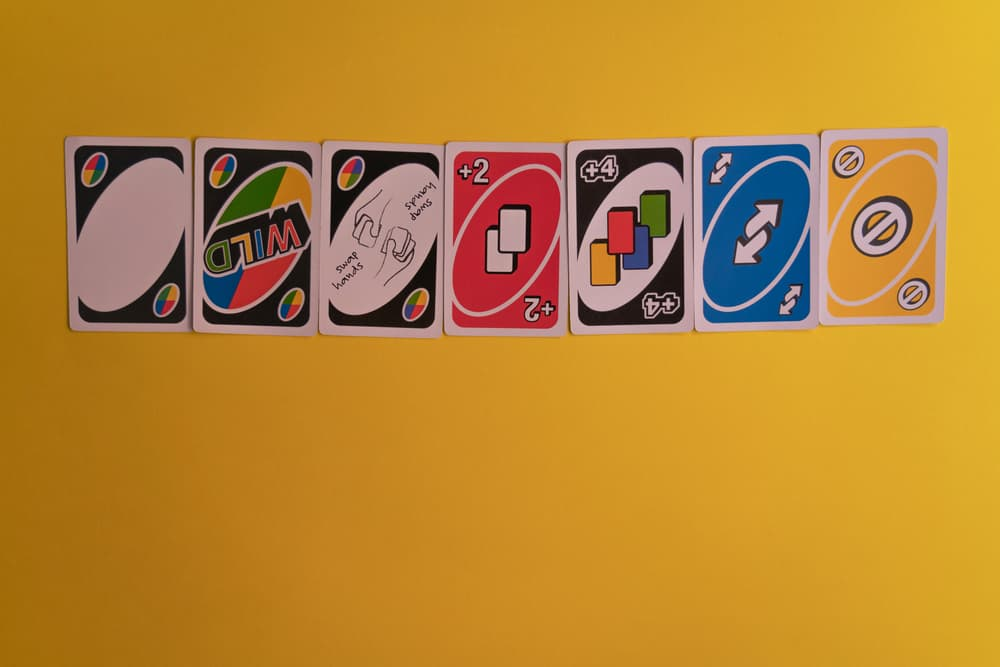 Uno special cards neatly arranged against yellow background