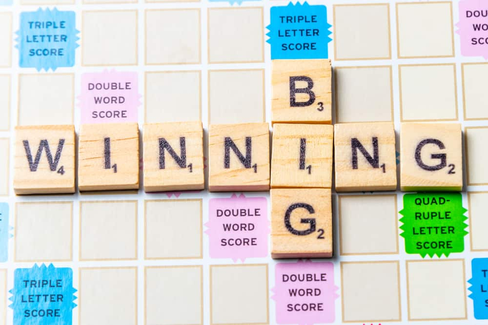 Words BIG and WINNING in scrabble letters over a scrabble board
